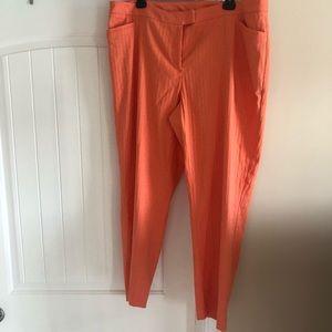 Peachy orange Capri ankle pants by Lane Bryant.
